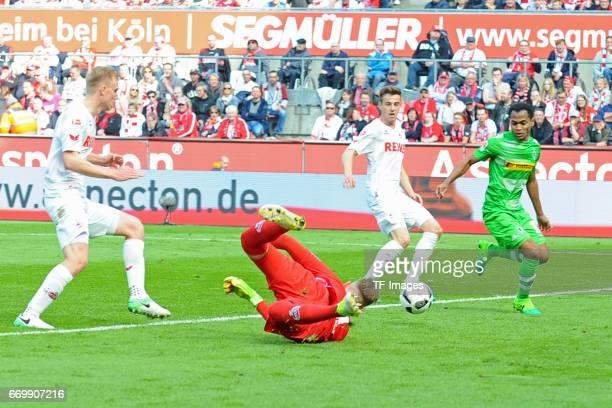 Frederik Soerensen of Koeln Timo Horn of Koeln Lukas Kluenter of Koeln and Raffael of Moenchengladbach battle for the ball during the Bundesliga...
