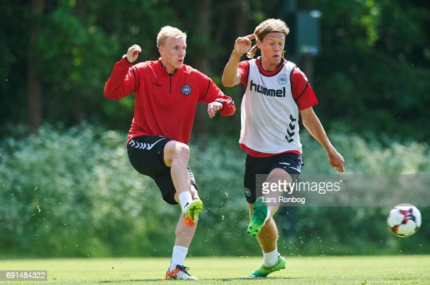 Frederik Sorensen and Jannik Vestergaard compete for the ball during the Denmark training session at Brondby Stadion on June 2 2017 in Brondby Denmark