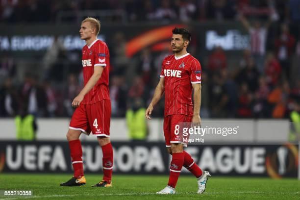Frederik Sorensen and Milos Jojic of FC Koeln look dejected after defeat in the UEFA Europa League group H match between 1 FC Koeln and Crvena Zvezda...