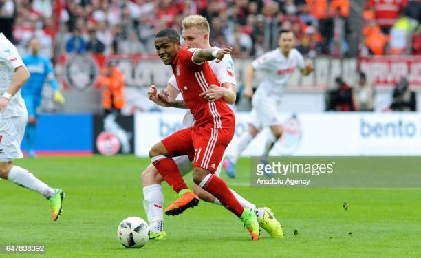 Frederik Sorensen of Cologne in action against Douglas Costa of Bayern Munich during the Bundesliga soccer match between 1 FC Cologne and FC Bayern...