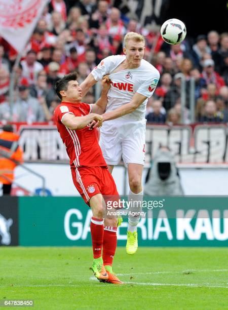 Frederik Sorensen of Cologne in action against Robert Lewandowski of Bayern Munich during the Bundesliga soccer match between 1 FC Cologne and FC...