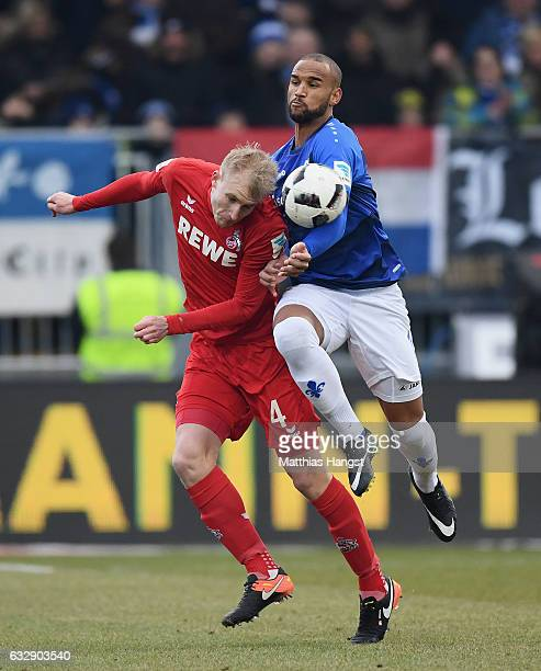 Frederik Sorensen of Koeln and Junior Diaz of Darmstadt compete for the ball during the Bundesliga match between SV Darmstadt 98 and 1 FC Koeln at...