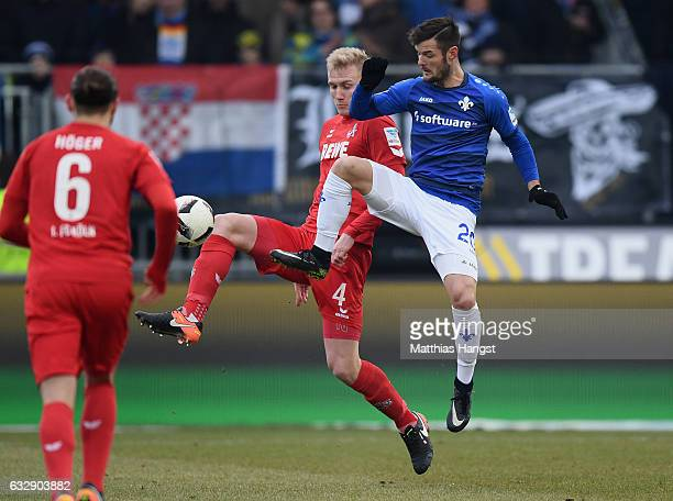 Frederik Sorensen of Koeln and Marcel Heller of Darmstadt compete for the ball during the Bundesliga match between SV Darmstadt 98 and 1 FC Koeln at...