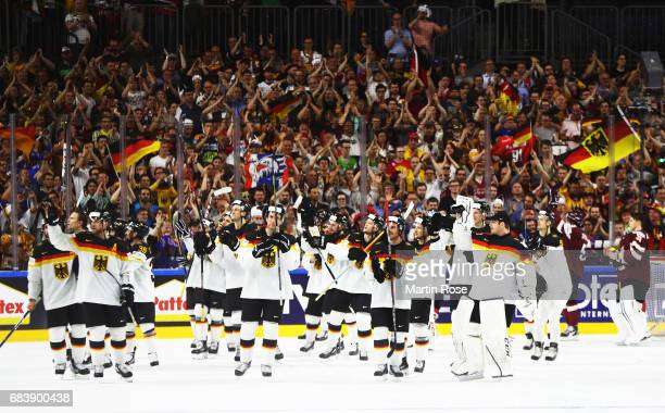 Frederik Tiffels of Germany celebrates victory with team mates after the Germany v Latvia match of the 2017 IIHF Ice Hockey World Championships at...