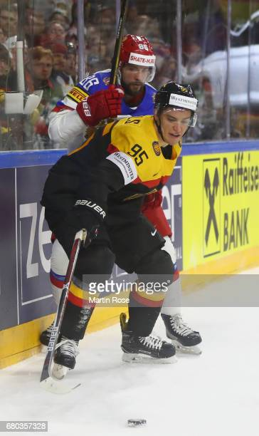 Frederik Tiffels of Germany is challenged by Nikita Kuckerov of Russia during the 2017 IIHF Ice Hockey World Championship game between Germany and...