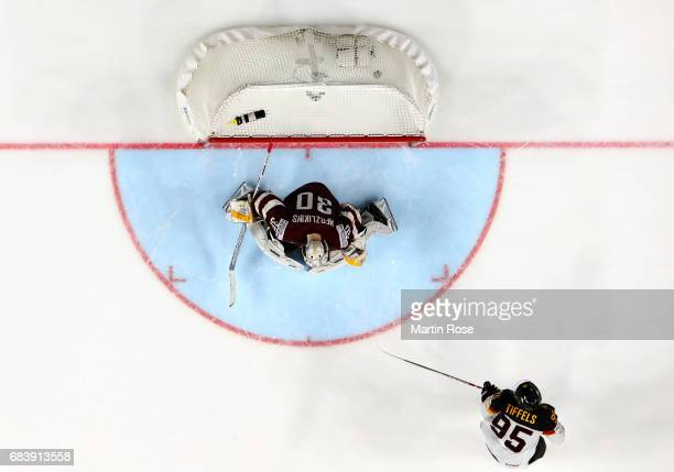 Frederik Tiffels of Germany scores the team winning goal during penalty shout out during the 2017 IIHF Ice Hockey World Championship game between...