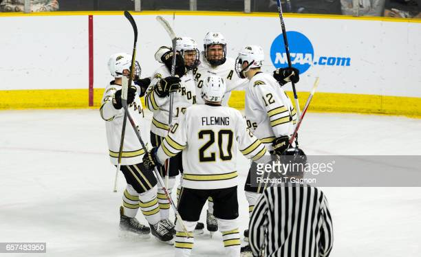 Frederik Tiffels of the Western Michigan Broncos celebrates his goal against the Air Force Falcons with his teammates Taylor Fleming Aidan Muir Aaron...