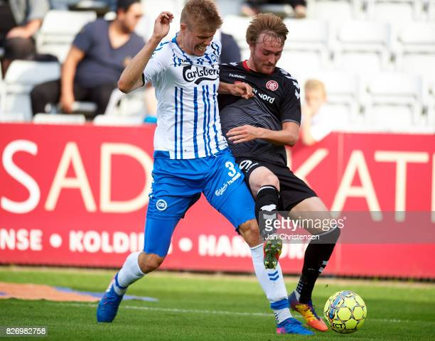 Frederik Tingager of OB Odense and Jannik Pohl of AaB Aalborg compete for the ball during the Danish Alka Superliga match between OB Odense and AaB...