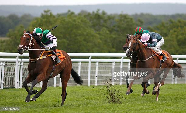 Frederik Tylicki riding The Twisler win The 888sport March Stakes at Goodwood racecourse on August 29 2015 in Chichester England