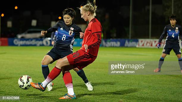 Frederike Kempe of Germany and Hikaru Naomoto of Japan fight for the ball during the women's U23 international friendly match between WU20 Germany...