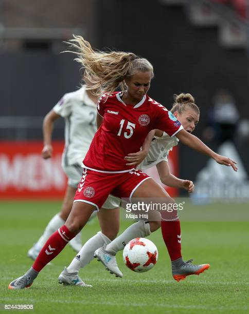 Frederikke Thogersen of Denmark and Linda Dallmann of Germany battle for possession during the UEFA Women's Euro 2017 Quarter Final match between...
