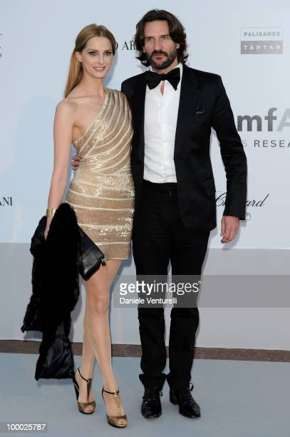 Frederique Bel and Frederic Beigbeder arrive at amfAR's Cinema Against AIDS 2010 benefit gala at the Hotel du Cap on May 20 2010 in Antibes France
