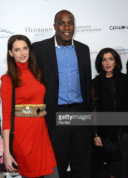 Frederique Bel Teddy Riner and Marion Bartoli attend the 'Winter Time 2013' Cocktail at L'Eclaireur Cafe on November 14 2013 in Paris France