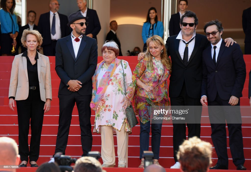 Frederique Bredin (L), directors JR, Agnes Varda, composer Matthieu Chedid and members of the cast pose as they attend the 'Faces, Places (Visages, Villages)' screening during the 70th annual Cannes Film Festival at Palais des Festivals on May 19, 2017 in Cannes, France.