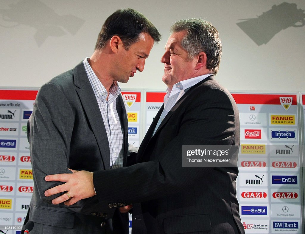 Fredi Bobic shakes hands with Ulrich Ruf finacial director of VfB Stuttgart after a press conference to present him as the new sports director of the...
