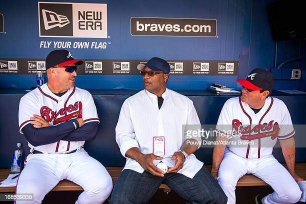 Fredi Gonzalez and Carlos Tosca of the Atlanta Braves in the dugout with Bo Jackson before the game against the Kansas City Royals at Turner Field on...