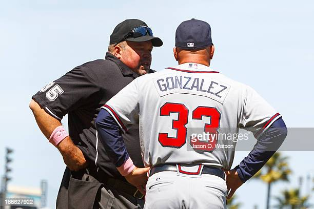Fredi Gonzalez of the Atlanta Braves argues a call with umpire Wally Bell in which Marco Scutaro of the San Francisco Giants was awarded a double...