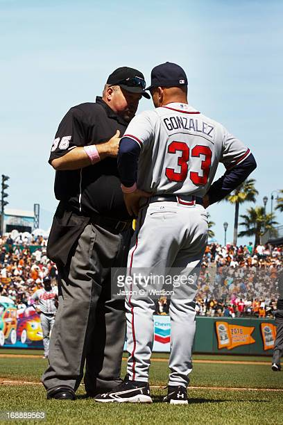 Fredi Gonzalez of the Atlanta Braves argues a call with umpire Wally Bell during the sixth inning against the San Francisco Giants at ATT Park on May...