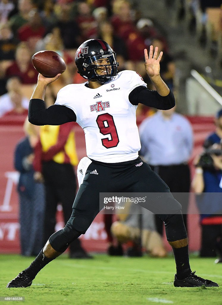 Fredi Knighten #9 of the Arkansas State Red Wolves passes against the USC Trojans at Los Angeles Coliseum on September 5, 2015 in Los Angeles, California.