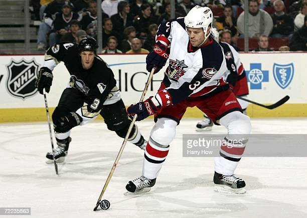 Frednik Modin of the Columbus Blue Jackets prepares to shoot the puck in front of Mark Eaton of the Pittsburgh Penguins during the first period at...