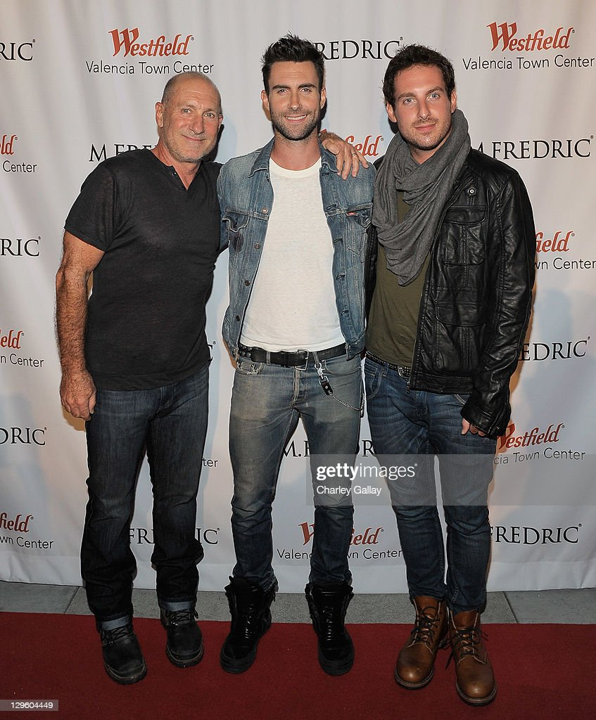 M. Fredric co-owner Fred Levine, singer Adam Levine and brother Michael Levine attend the grand opening of M. Fredric at Westfield Valencia Town Center on October 18, 2011 in Valencia, California.