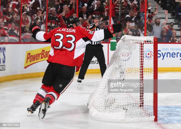 Fredrik Claesson of the Ottawa Senators celebrates after a goal by teammate Mike Hoffman on the Pittsburgh Penguins in Game Six of the Eastern...