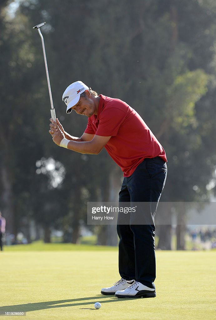 Fredrik Jacobson of Sweden reacts to his missed putt for par to force a three way playoff on the 18th green during the final round of the Northern Trust Open at the Riviera Country Club on February 17, 2013 in Pacific Palisades, California.