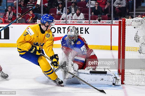 Fredrik Karlstrom of Team Sweden is stopped by goaltender Ilya Samsonov of Team Russia during the 2017 IIHF World Junior Championship bronze medal...