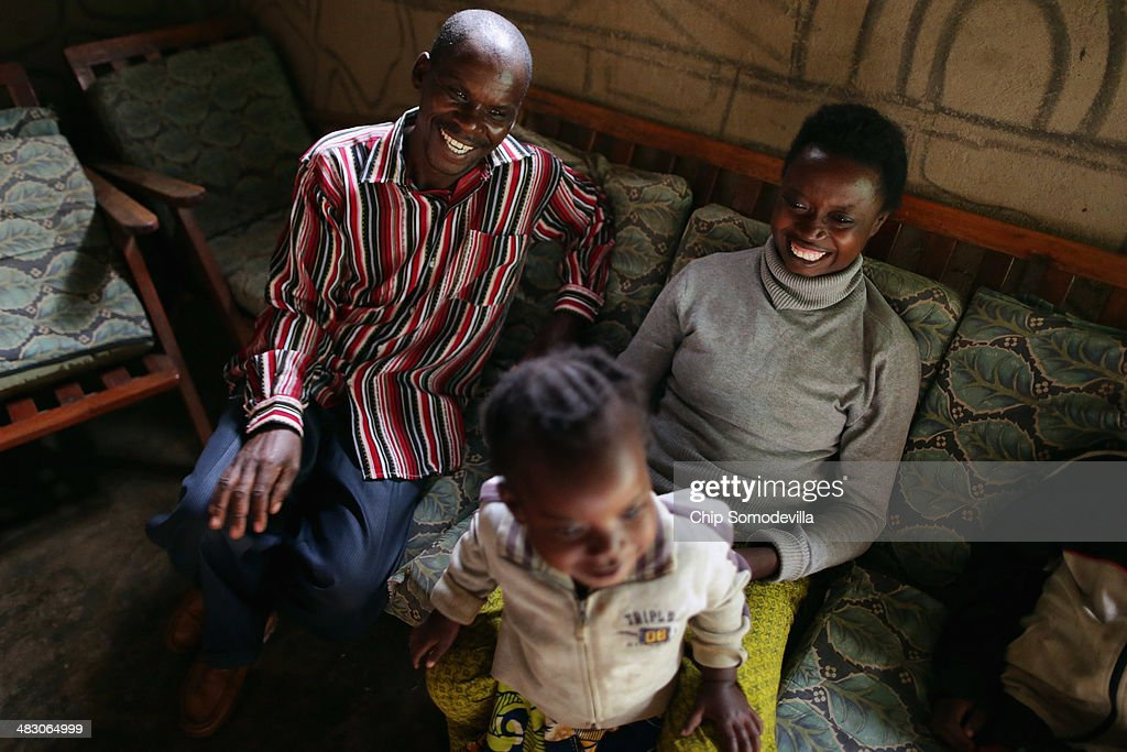Fredrik Kazibwemo (L), 45, visits with neighbors Leonae Mugirwanake and her daughter Caline Nijogisubizo, 3, at a genocide 'reconciliation village' April 6, 2014 in Mybo, Rwanda. Fredrik served eight years in prison for killing nine people during the country's 1994 genocide. After moving to Mbyo, Fredrik said he was surprised when a neighbor who survived the killing offered to help pay his childrens' school fees, beginning a cycle of friendship. Organized by the Prison Fellowship Rwanda in 2004, this village of 285 is where those who served time in prison for genocide now live side-by-side with people who survived the killer's 1994 rampage. One of five communities like this in Rwanda, Mbyo residents share agriculture and handicraft cooperatives and say that working together has helped with reconciliation, easing their apprehension and fostering new friendships. Rwanda is preparing to commemorate the 20th anniversary of the country's 1994 genocide, when more than 800,000 ethnic Tutsi and moderate Hutus were slaughtered over a 100 day period.