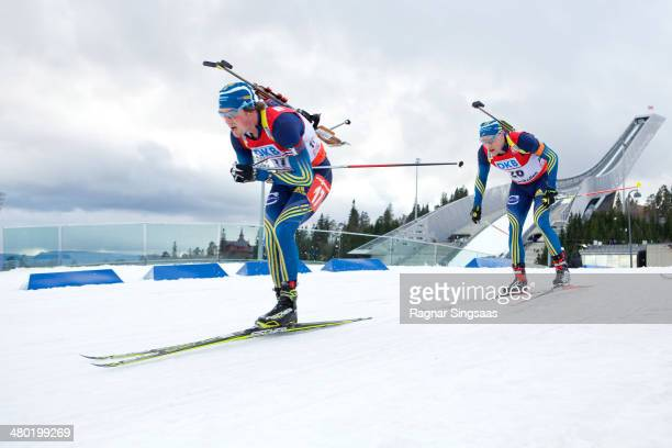 Fredrik Lindstroem of Sweden and Carl Johan Bergman of Sweden compete during the IBU Biathlon World Cup Men's 15 kilometer Mass Start race on March...