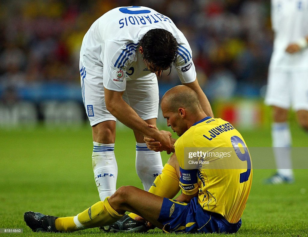 Fredrik Ljungberg of Sweden is helped to his feet by Giourkas Seitaridis of Greece during the UEFA EURO 2008 Group D match between Greece and Sweden...