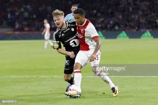 Fredrik Midtsjo of Rosenborg BK Justin Kluivert of Ajax during the UEFA Europa League fourth round qualifying first leg match between Ajax Amsterdam...