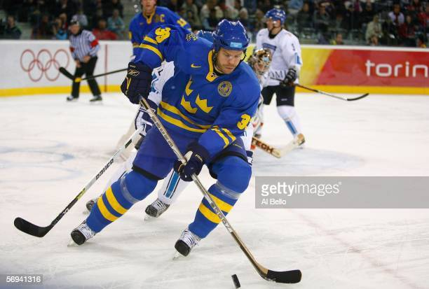 Fredrik Modin of Sweden controls the puck during the final of the men's ice hockey match between Finland and Sweden during Day 16 of the Turin 2006...
