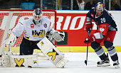Fredrik Pettersson Wentzel of HV71 Jonkoping and Daniel Welser of Red Bull Salzburg during the Champions Hockey League group stage game between Red...