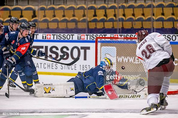 Fredrik PetterssonWentzel goaltender of HV71trying to reach the shot from Juraj Mikus of Sparta Prague but has no luck so he scores during the...