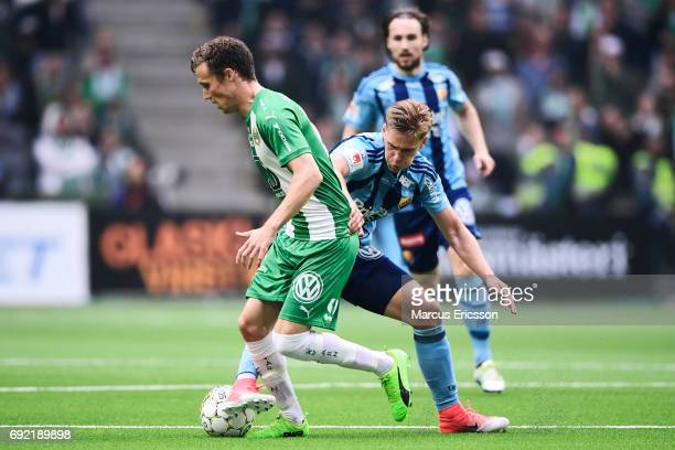 Fredrik Torsteinbø of Hammarby IF and Felix Beijmo of Djurgardens IF competes for the ball during the Allsvenskan match between Hammarby IF and...