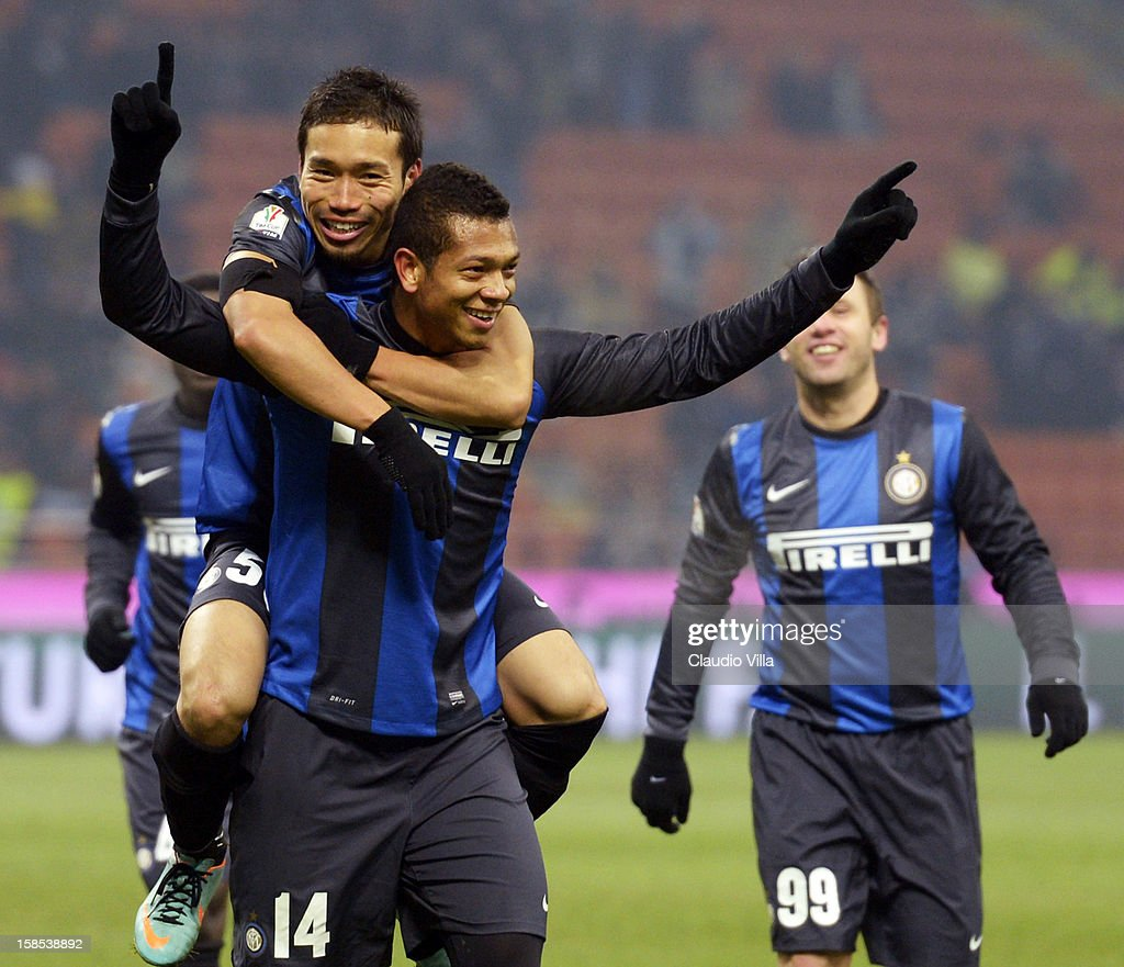 Fredy Guarin of FC Inter #14 celebrates with team-mate <a gi-track='captionPersonalityLinkClicked' href=/galleries/search?phrase=Yuto+Nagatomo&family=editorial&specificpeople=4320811 ng-click='$event.stopPropagation()'>Yuto Nagatomo</a> after scoring during the TIM Cup match between FC Internazionale Milano and Hellas Verona at San Siro Stadium on December 18, 2012 in Milan, Italy.