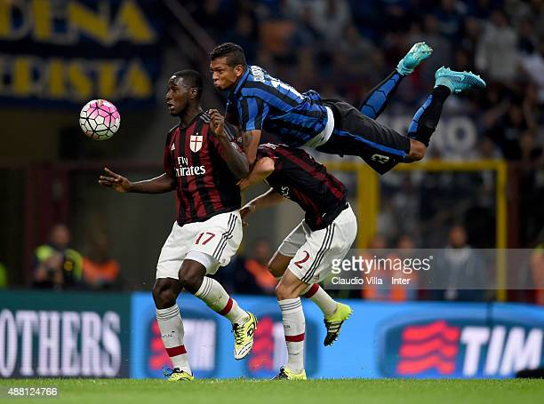Fredy Guarin of FC Internazionale and Cristian Zapata of AC Milan compete for the ball during the Serie A match between FC Internazionale Milano and...