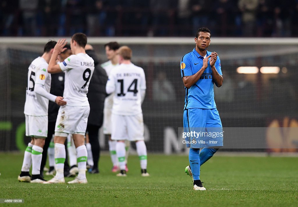 <a gi-track='captionPersonalityLinkClicked' href=/galleries/search?phrase=Fredy+Guarin&family=editorial&specificpeople=746933 ng-click='$event.stopPropagation()'>Fredy Guarin</a> of FC Internazionale (R) reacts at the end of the UEFA Europa League Round of 16 match between FC Internazionale Milano and VfL Wolfsburg at Stadio Giuseppe Meazza on March 19, 2015 in Milan, Italy.
