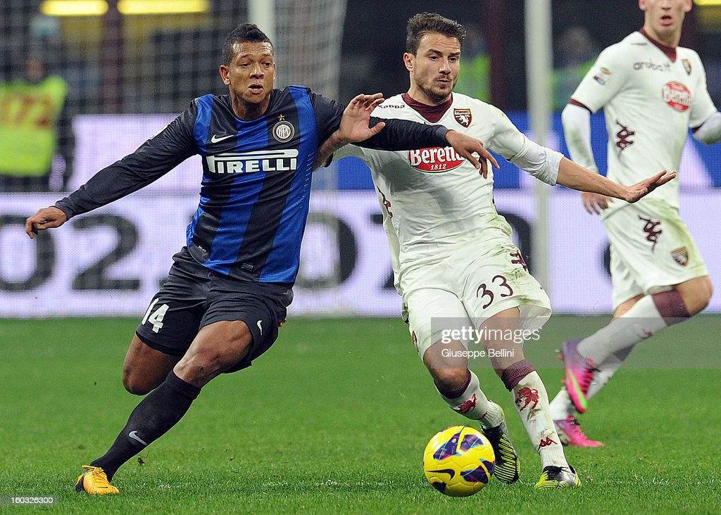 Fredy Guarin (L) of Inter is challenged by Matteo Brighi of Torino during the Serie A match between FC Internazionale Milano and Torino FC at San Siro Stadium on January 27, 2013 in Milan, Italy.
