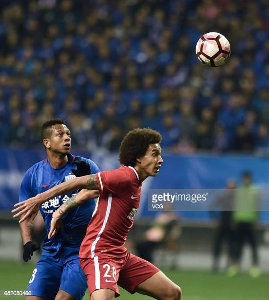 Fredy Guarin of Shanghai Shenhua and Axel Witsel of Tianjin Quanjian compete for the ball during the 2nd round match of CSL Chinese Football...