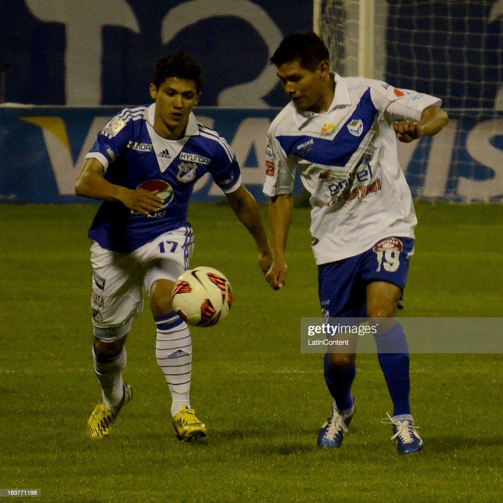 Fredy Montero of Millonarios struggles for the ball with Luis Torrico of San Jose during a match between Millonarios and San Jose as part of Copa Bridgestone Libertadores 2013 at Jesús Bermúdez Stadium on March 14, 2013 in San Jose de Oruro, Bolivia.