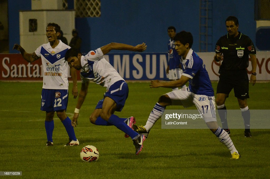 Fredy Montero of Millonarios struggles for the ball with Roly Sejas of San Jose during a match between Millonarios and San Jose as part of Copa Bridgestone Libertadores 2013 at Jesús Bermúdez Stadium on March 14, 2013 in San Jose de Oruro, Bolivia.