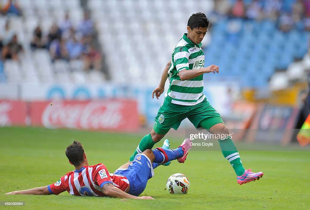 <a gi-track='captionPersonalityLinkClicked' href=/galleries/search?phrase=Fredy+Montero&family=editorial&specificpeople=5563695 ng-click='$event.stopPropagation()'>Fredy Montero</a> (R) of Sporting Clube de Portugal is tackled by Luis Hernandez of Real Sporting de Gijon during the Teresa Herrera Trophy match at Estadio Municipal de Rizor on August 9, 2014 in A Coruna, Spain.