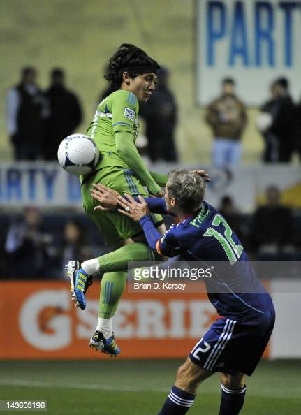 Fredy Montero of the Seattle Sounders and Logan Pause of the Chicago Fire go for the ball at Toyota Park on April 28 2012 in Bridgeview Illinois The...