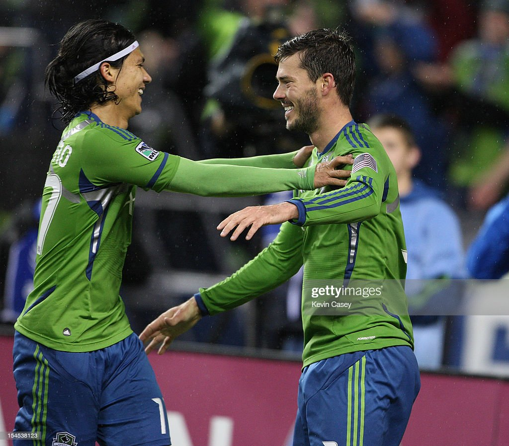 <a gi-track='captionPersonalityLinkClicked' href=/galleries/search?phrase=Fredy+Montero&family=editorial&specificpeople=5563695 ng-click='$event.stopPropagation()'>Fredy Montero</a> #17 (L) of the Seattle Sounders congratulates teammate Brad Evans #3 after he scored a goal on a penalty in the first half against FC Dallas at CenturyLink Field on October 21, 2012 in Seattle, Washington.
