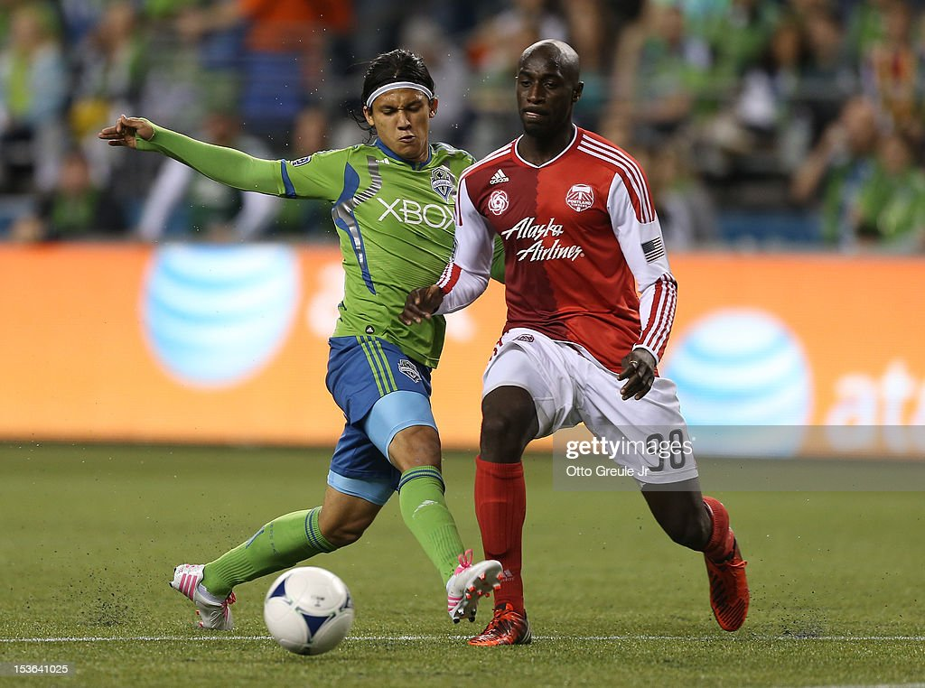 <a gi-track='captionPersonalityLinkClicked' href=/galleries/search?phrase=Fredy+Montero&family=editorial&specificpeople=5563695 ng-click='$event.stopPropagation()'>Fredy Montero</a> #17 of the Seattle Sounders FC battles Mamadou 'Futty' Danso #98 of the Portland Timbers at CenturyLink Field on October 7, 2012 in Seattle, Washington. The Sounders defeated the Timbers 3-0.