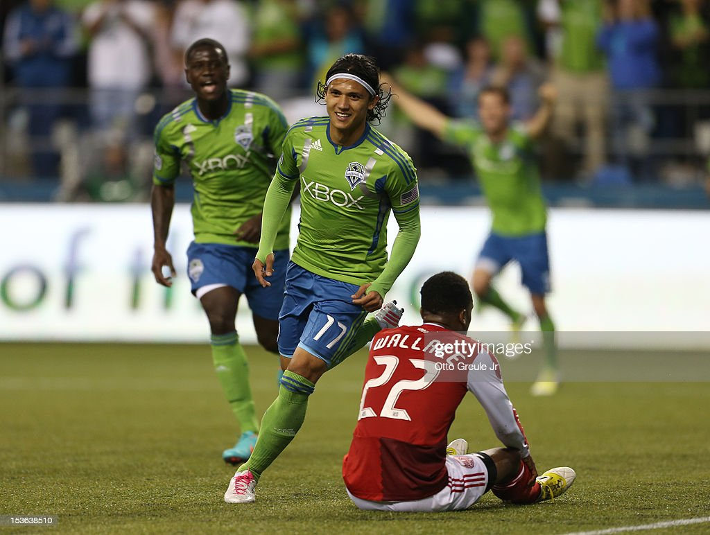 <a gi-track='captionPersonalityLinkClicked' href=/galleries/search?phrase=Fredy+Montero&family=editorial&specificpeople=5563695 ng-click='$event.stopPropagation()'>Fredy Montero</a> #17 of the Seattle Sounders FC celebrates after scoring a goal against the Portland Timbers at CenturyLink Field on October 7, 2012 in Seattle, Washington.
