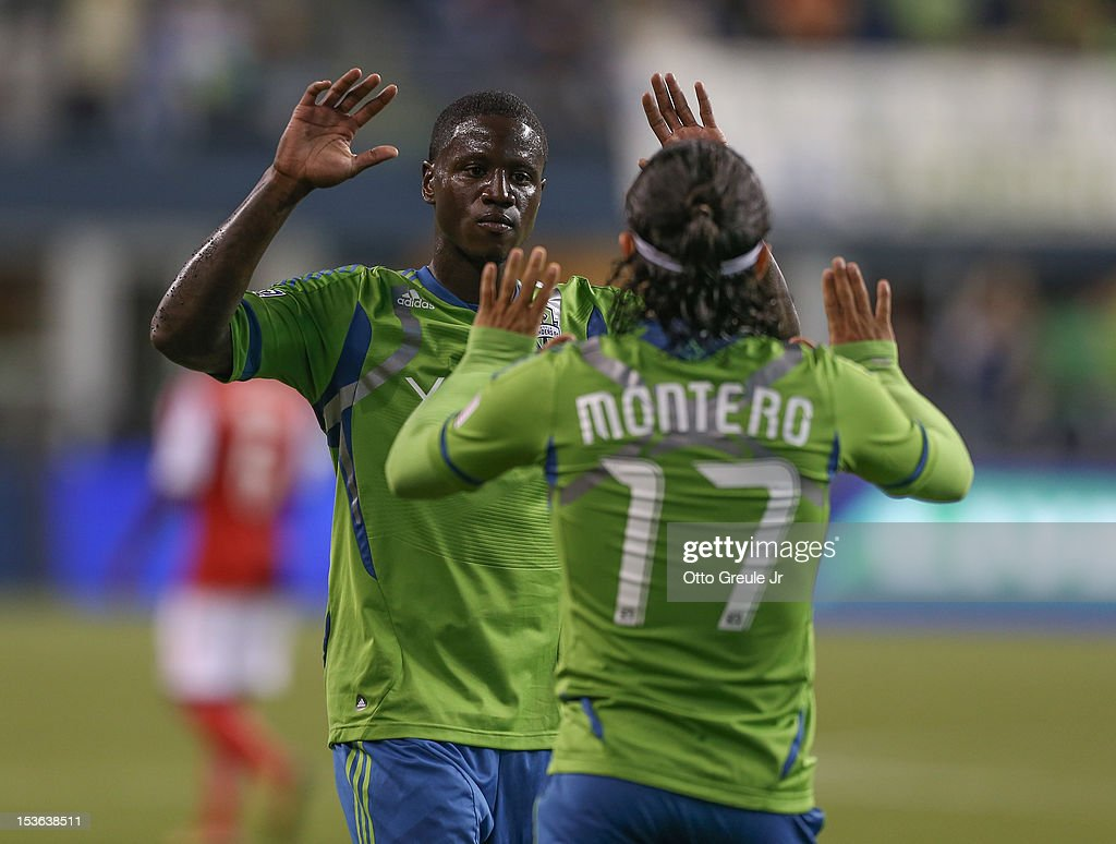 <a gi-track='captionPersonalityLinkClicked' href=/galleries/search?phrase=Fredy+Montero&family=editorial&specificpeople=5563695 ng-click='$event.stopPropagation()'>Fredy Montero</a> #17 of the Seattle Sounders FC celebrates with Eddie Johnson #7 after scoring his second goal against the Portland Timbers at CenturyLink Field on October 7, 2012 in Seattle, Washington.