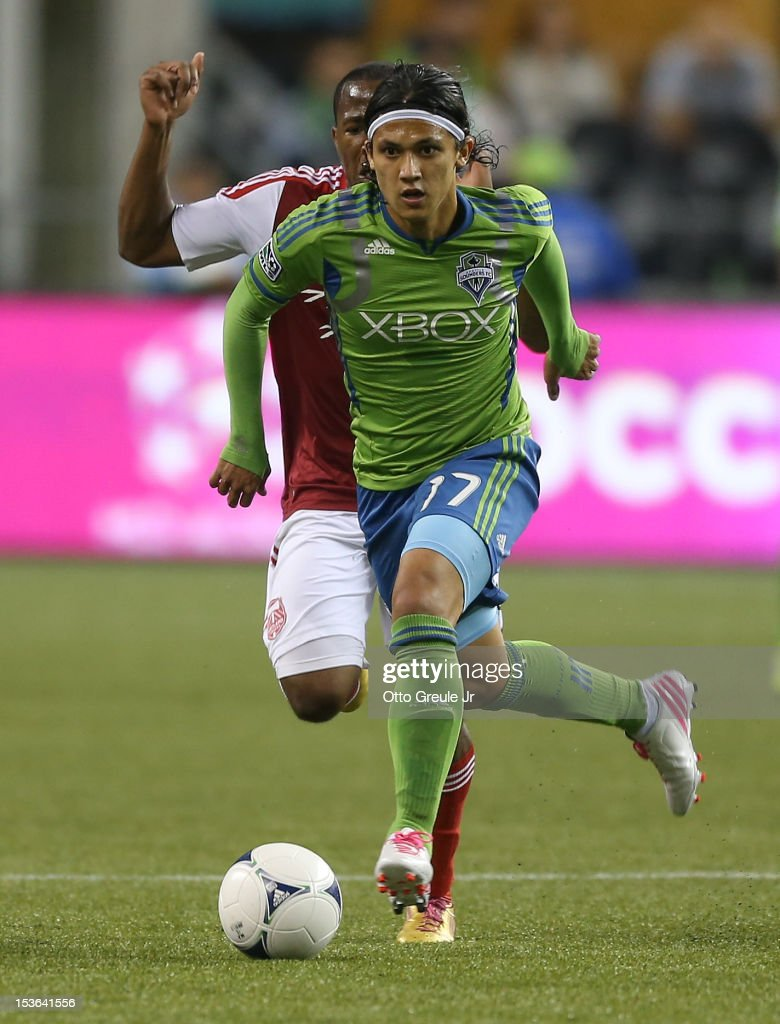 <a gi-track='captionPersonalityLinkClicked' href=/galleries/search?phrase=Fredy+Montero&family=editorial&specificpeople=5563695 ng-click='$event.stopPropagation()'>Fredy Montero</a> #17 of the Seattle Sounders FC dribbles against <a gi-track='captionPersonalityLinkClicked' href=/galleries/search?phrase=Darlington+Nagbe&family=editorial&specificpeople=6588276 ng-click='$event.stopPropagation()'>Darlington Nagbe</a> #6 of the Portland Timbers at CenturyLink Field on October 7, 2012 in Seattle, Washington. The Sounders defeated the Timbers 3-0.